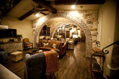love the mix of stone & brick maybe on either side of family room going into kitchen & wine cellar