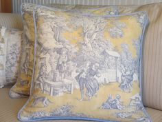Blue and yellow French Country toile pillows.