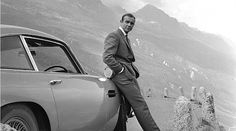 "Sean Connery posing by this 1964 Aston Martin in Switzerland for the James Bond movie ""Goldfinger"". Sean Connery and the 007 franchise would achieve world-renowned status and never look back. Sean Connery James Bond, Aston Martin Db5, Style James Bond, Jaguar E Typ, Bond Cars, The Blues Brothers, The Ghostbusters, Film Serie, Fast And Furious"