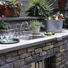 this stone outdoor kitchen is lovely