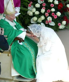 Devout Roman Catholic: Pope John Paul II pictured receiving a hand kiss by Fabiola during the beatification ceremony of Charles Hapsburg on October 3, 2004, at St Peter's Square in Vatican City