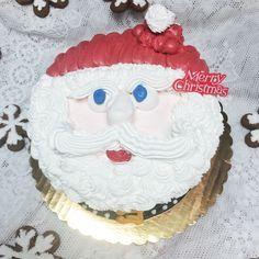 Large Santa head cake from Mueller's Bakery!