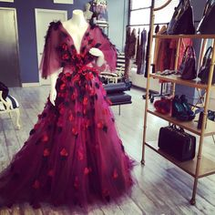 Petal appliqué gown on display in the showroom today.