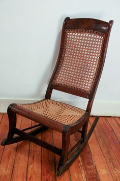 Antique Wooden Rocking Chair With Wicker Seat And By Lesterhead