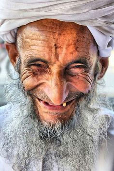 Omani smile I don't know who this guy is but he could be somebody the US taught to farm and his life was changed forever, see his joy.