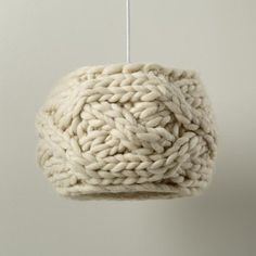 This pendant's thick ropes of wool allow for a soft overhead glow – just how we like it.