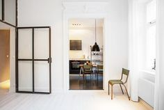 Tour a Minimal Apartment With Stunning Architectural Details via @domainehome