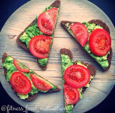 Healthy snack, mmm mashed avacado and sliced tomatoes on whole wheat bread!