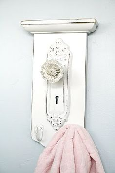 Love this towel hanger from an old glass doorknob.  So perfect!
