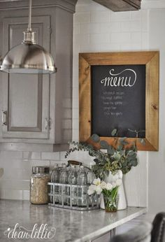 Could do a menu chalkboard above the phone or on the side of the fridge