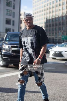 Russell Westbrook, basketball player and Barney's guest editor, wears denim plaid shirt around his waist, and Rick Owens jeans outside the Altuzarra show at Spring Studios on September 2016 in New York City. Russell Westbrook Face, Russell Westbrook Outfits, Russel Westbrook Fashion, Westbrook Shoes, Nba Fashion, Streetwear Fashion, Mens Fashion, Fashion Outfits, Outfits