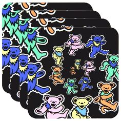 Add a touch of class to your Grateful Dead collection with this 4-piece coaster set, featuring enameled tops with the Dead's iconic Dancing Bears scattered in a crisp full-color graphic and quality non-slip cork bottoms. An incredible set for Grateful Dead fans with a flair for the domestic, and Dead Heads who can't wait to put their drinks down to dance. Dimensions: 3.75 in H x 3.75 in W