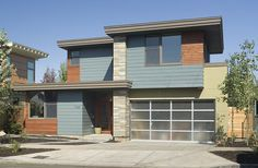 Architectural Designs 3 bed modern house plan 69446AM built again. Ready when you are. Where do YOU want to build?