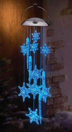 """blue """"snowflake"""" wind-chimes - Mia would love these. They look like they are from the movie Frozen. Hang them outside her window and she could pretend to be Elsa anytime she wanted to be. Blue Christmas Decor, Small Christmas Trees, Christmas Lanterns, Decorating With Christmas Lights, Christmas Decorations, Magical Christmas, Christmas Items, Mobiles, Blowin' In The Wind"""