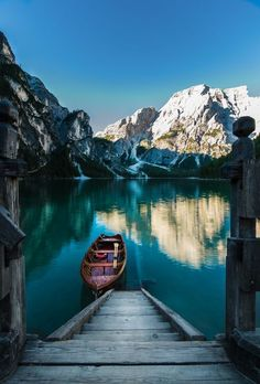 Lago di Braies in Italy. We were extremely lucky to have a nice sunrise!  In our vacation we went to Lago di Braies for the second time, just for pics. Our alarm clock was set at 5 o'clock. Followed by a 1,5 hour car drive. I went to the boathouse and it was not open. So my tall boyfriend helped me on pier. A little bit scary! It was not allowed.  This is one of the places that changed my mind. No allinclusive flights anymore, just an appartment on top of the mountain going by car!