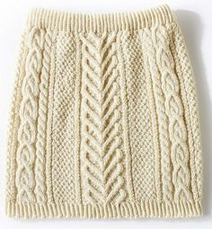 Step up your fall wardrobe with this stylish cable knit skirt, worked in the round.