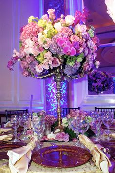 Tall floral centerpiece by David Tutera