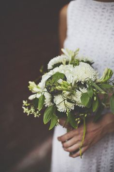 green and white bouquet with lotus pod