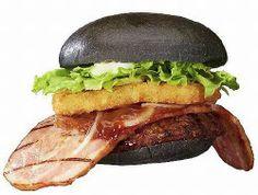 Japanese burger with black hamburger buns and a HUGE slab of bacon