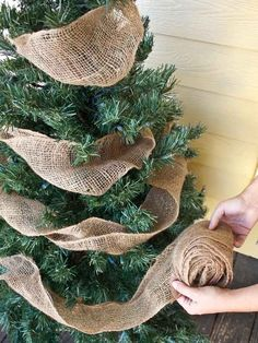 Just a simple burlap garland will spruce up any front porch Christmas tree. Just a simple burlap garland will spruce up any front porch Christmas tree.,It's the most wonderful time of the year Just. Porch Christmas Tree, Noel Christmas, Merry Little Christmas, Winter Christmas, Christmas Wreaths, Christmas Trees With Burlap, Outdoor Christmas, Burlap Christmas Decorations, Christmas Tree Ideas