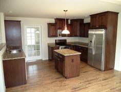 Kitchen from a Logan I home (13.90)  Granite Countertops and kitchen cabinets