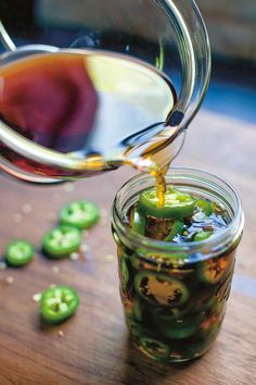 pickled jalapeno peppers, a Korean staple, are made with soy sauce, garlic, and rice vinegar Pickled Jalapeno Recipe, Pickled Jalapeno Peppers, Jalapeno Sauce, Pickled Garlic, Pickling Jalapenos, Pickled Eggs, Jalapeno Recipes, Stuffed Jalapeno Peppers, Tacos