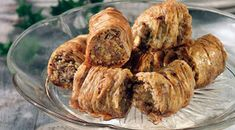 Saragli / Greek Christmas Phyllo Rolls With Pistachios And Walnuts Recipe (Amateur Cook Professional Eater) Greek Sweets, Greek Desserts, Greek Recipes, Pastry Recipes, Cooking Recipes, Greek Christmas, The Kitchen Food Network, Walnut Recipes, Sweets Cake