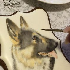 Hand painted German shepherd on gingerbread. #dog #painted #painteddog#germanshepherd#handpainted #gingerbread #mezesmanna #paintedcookies#handmaide#cute #lovely #ilovedogs