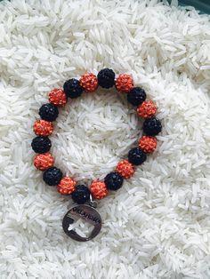 Orange and black Oklahoma bling bracelets   https://m.facebook.com/roserockboutique1/?ref=bookmarks