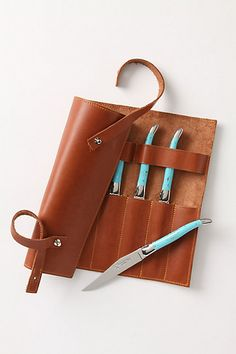 The handles on this Laguiole knife set are made of real turquoise--soooo beautiful, but, Mon Dieu, come with a $1200 price tag! (Not in my lifetime, sigh)