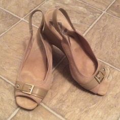"Anne Klein Tan Wedge Sandal Stylish Anne Klein Perfered Slingback Wedge sandal.   Tan colored buckle upper, faux sling clasp elastic band. Textile upper with a cushioned sole. Approximately 3"" heel. This beautiful pair of shoes are in EXCELLENT condition. All reasonable offers are considered. Anne Klein Shoes Wedges"