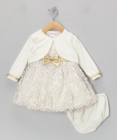 This super set has everything a little lady needs to look her best, including a precious dress with a zipper back and a coordinating diaper cover and creamy cardigan to tie the whole look together.