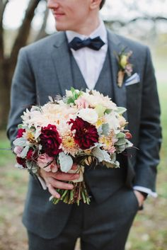 The groom holding the bouquet: http://www.stylemepretty.com/little-black-book-blog/2014/12/23/rustic-elegance-at-sweetwater-farm/ | Photography: Ciro - http://cirophotography.com/