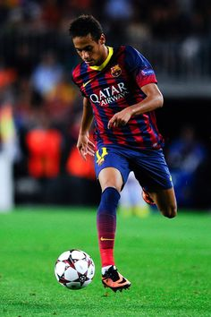 Neymar of FC Barcelona runs with the ball during the UEFA Champions League Group H match between FC Barcelona and Ajax Amsterdam ag the Camp Nou stadium on September 18, 2013 in Barcelona, Catalonia.