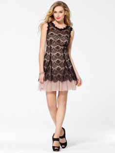 Sweet dress with of pale tulle with intricate black lace top layer. Sleeveless. Flared Skirt.  35 1/2 inch body length40% Cotton 30% Nylon 30% RayonTulle: 100% Nylon Lining: 100% PolyesterMade in USAS