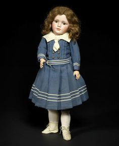 A rare Simon & Halbig 1448 bisque head character doll