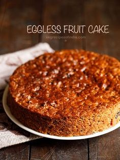 eggless christmas fruit cake recipe with step by step photos – this fruit cake has a wonderful fragrant aroma and is light, crumbly, moist and too delicious with notes of rum in it.