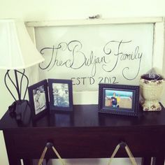 DIY Vintage window sign. Window from antique store + bistro chalk pen= family name in entry way.