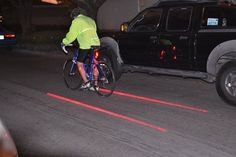 Xfire Safety Light creates an illuminated bike lane... Bikers rights!