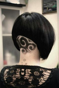 short hair back tattoo