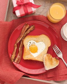 "For my red plate!!  Heart Shaped Eggs and Toast.    We love making ""birds nests"" with a round cookie cutter, but why have I not thought of this?  Any shape would be fun. Someday way in the future for a boyfriend. Very cute. I would also love if someone did this for me."