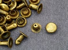 Vienna La Rouge's brass nailhead rivet studs for the detail on the 'skirts' of the blue leather battledress.