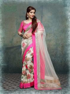 Try something new that's perfect for this rugged trend  as you wear this pink border saree. Designed with absolute perfection, this floral orepe print skirt with net pallu saree  is soft against the skin and will keep you at ease.