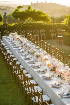 Invite guests to sit at long banquet tables at your wedding reception.