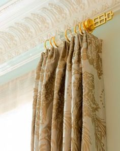 lucite rods with gold detail..love it for the bathroom