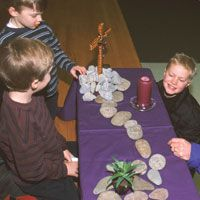 Prayer Table for the First Week of Lent  Love this idea...Crucifix on one end stones leading to the tomb