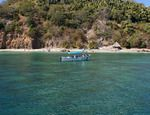 A shing boat sails the turquoise waters of Jaltemba Bay on Mexico's Nayarit Riviera