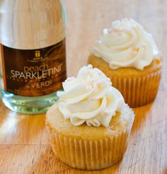 Peach Bellini Cupcakes - a classic brunch cocktail turned cupcake. Fluffy peach cupcakes topped with tangy champagne buttercream. Peach Cupcakes, Cocktail Cupcakes, Pretty Cupcakes, Yummy Cupcakes, Wedding Cupcakes, Alcohol Infused Cupcakes, Alcoholic Cupcakes, Flavored Cupcakes, Drunken Cupcakes