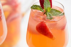 Strawberry-Basil Lemonade: Spiked or Unspiked ~ Strawberry-Basil Lemonade: A perfect combination of sweet strawberry syrup, fresh basil, and tart lemons. Turn this lemonade into a cocktail by adding vodka. Strawberry Basil Lemonade, Honey Lemonade, Strawberry Sangria, Flavored Lemonade, Homemade Lemonade Recipes, Strawberry Syrup, Mango Sangria, Summer Sangria, Summer Drink Recipes