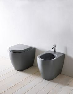 """CIELO's Smile Collection: young appeal, easy-chic, just like the name suggests. Greatest functionality and attention to design are its strength. In the photo, floor mounted wc and bidet are proposed in Brina finish from the """"Terre di Cielo"""", the all-new range of finishes inspired by the colors of the dirt, plants, natural elements and minerals. #Cielo #handmade #ceramic #bathroomdesign #madeinitaly"""